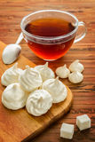 Homemade meringue and tea on a table Royalty Free Stock Images