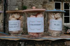 Homemade meringues for sale in small village of Lacock, England. stock photos