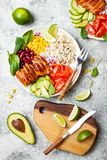 Homemade Mexican chicken burrito bowl with rice, beans, corn, tomato, avocado, spinach. Taco salad lunch bowl. Homemade Mexican chicken burrito bowl with rice royalty free stock photos