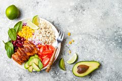 Homemade Mexican chicken burrito bowl with rice, beans, corn, tomato, avocado, spinach. Taco salad lunch bowl. Homemade Mexican chicken burrito bowl with rice Royalty Free Stock Photography