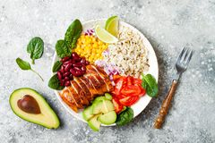 Homemade Mexican chicken burrito bowl with rice, beans, corn, tomato, avocado, spinach. Taco salad lunch bowl. Homemade Mexican chicken burrito bowl with rice royalty free stock photo