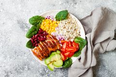 Homemade Mexican chicken burrito bowl with rice, beans, corn, tomato, avocado, spinach. Taco salad lunch bowl. Homemade Mexican chicken burrito bowl with rice Stock Image