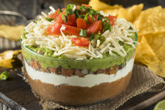 Homemade Mexican 7 Layer Dip. With Beans, Sour Cream and Guacamole royalty free stock photos