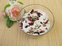 Homemade milk bath with flowers Stock Images