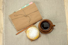 Homemade milk biscuits, a cup of coffee and notepad Stock Photos