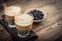 Homemade Milk Bubble Tea. With Tapioca Pearls on wooden background Royalty Free Stock Photography
