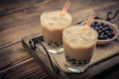 Homemade Milk Bubble Tea. With Tapioca Pearls on wooden background stock image