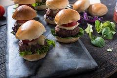 Homemade mini beef burgers Royalty Free Stock Photo