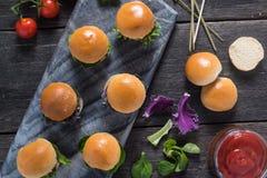 Homemade mini beef burgers Royalty Free Stock Photos