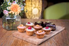 Homemade mini cupcakes on a wooden board. royalty free stock images