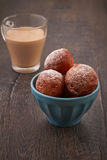 Homemade mini doughnuts. Baked doughnuts with glass of cappucino royalty free stock image