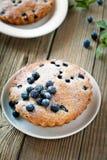 Homemade mini fresh blueberry pies on white plate Stock Photos