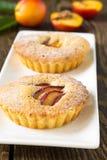 Homemade mini peach cake on white plate Royalty Free Stock Photo