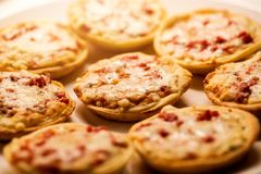 Homemade mini pizza snacks on a plate Stock Photos
