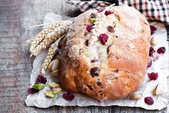 Homemade mixed fruit and nut white bread on wooden table royalty free stock photos