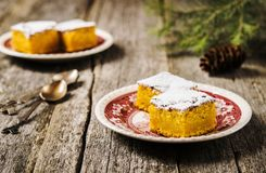 Homemade moist pumpkin pie dusted with powdered sugar and chopped slices Royalty Free Stock Photo