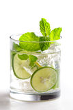 Homemade mojito cocktail with fresh limes, mint, and ice Royalty Free Stock Photography