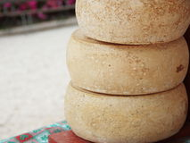 Homemade Mountain Cheese. At a local market stall Stock Photo