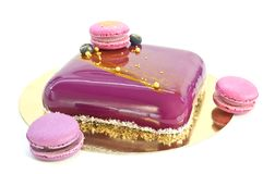 Homemade mousse cake and macaroons Stock Image