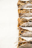 Homemade muesli bars with dried fruit, nuts and oatmeal Royalty Free Stock Photos