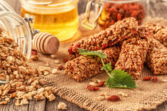 Homemade muesli bars with fruit and nuts. Royalty Free Stock Images