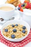 Homemade muesli with blueberries, berries, cappuccino and milk Stock Photos