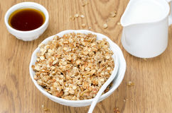 Homemade muesli, jug of milk and a bowl of honey for breakfast Stock Photography