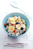 Homemade muesli topped with fruit and buts Royalty Free Stock Image