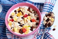 Homemade muesli with yogurt. Bowl of cereals Stock Photo