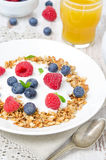 Homemade muesli with yogurt, raspberries, blueberries and orange Royalty Free Stock Photo