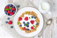 Homemade muesli with yogurt, raspberries, blueberries top view Stock Photo