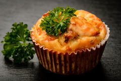 Homemade muffin with chicken and cheese on black board. Stock Photography