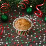 Homemade muffin with star decoration on wooden background. royalty free stock images