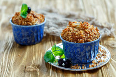 Homemade muffins with blackberry and a sprig of mint. Stock Image
