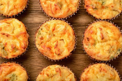 Homemade muffins with chicken and cheese on  wooden board. Stock Photos
