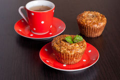 Homemade muffins and cup of tea. Horizontal, close up Stock Image