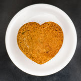 Homemade muffins heart shaped on white plate royalty free stock photos