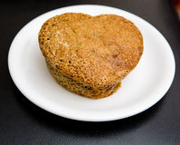 Homemade muffins heart shaped on white plate Royalty Free Stock Images