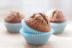 Homemade muffins on the kitchen table. Sweet homemade muffins on the kitchen table in blue pastry case Royalty Free Stock Images