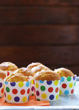 Homemade muffins in paper cups Royalty Free Stock Photography