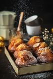 Homemade muffins with powdered sugar and coffee on dark background, t. royalty free stock photo