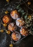 Homemade muffins with powdered sugar on a dark background, selective focus. Romantic concept royalty free stock photos