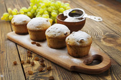 Homemade muffins with raisins and powdered sugar Stock Photography