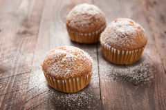 Homemade muffins on a wooden table Stock Images