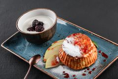 Homemade muffins with yogurt, blueberry, apple and jam in plate on dark stone background. Healthy breakfast.  stock images