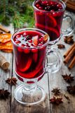 Homemade mulled wine with orange slices, cranberries, cinnamon and anise Stock Photo