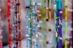 Homemade multi-colored beads. royalty free stock photography