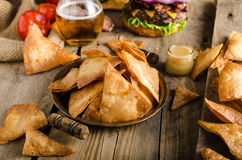 Homemade nachos with rustic burger Royalty Free Stock Photo