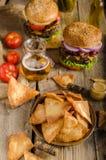 Homemade nachos with rustic burger Royalty Free Stock Photos