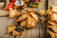 Homemade nachos with rustic burger Stock Photos